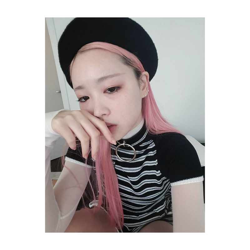 Pink-haired model Fernanda Ly shares an Instagram photo.