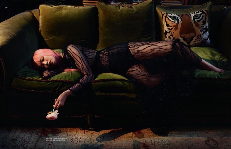Fernanda Ly models a black and sheer Gucci dress