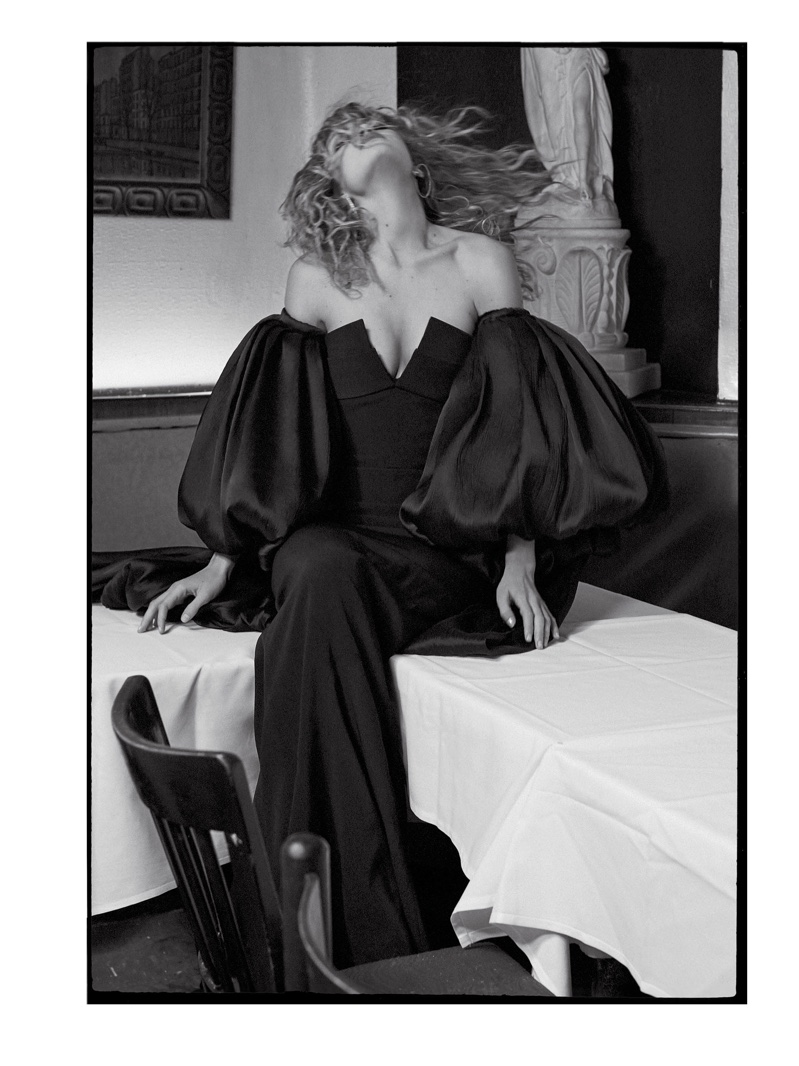 Captured in black and white, Gigi models a Brandon Maxwell dress with puffed sleeves