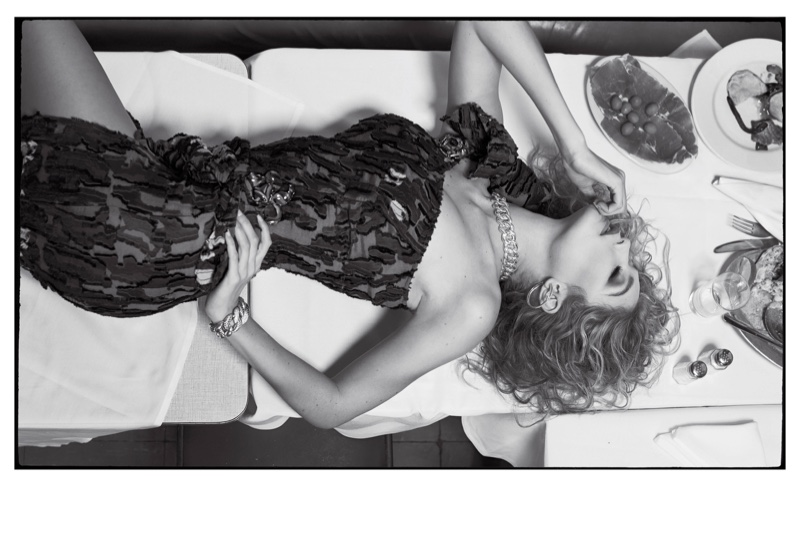 Photographed by Sebastian Faena, Gigi Hadid wears a Versace dress