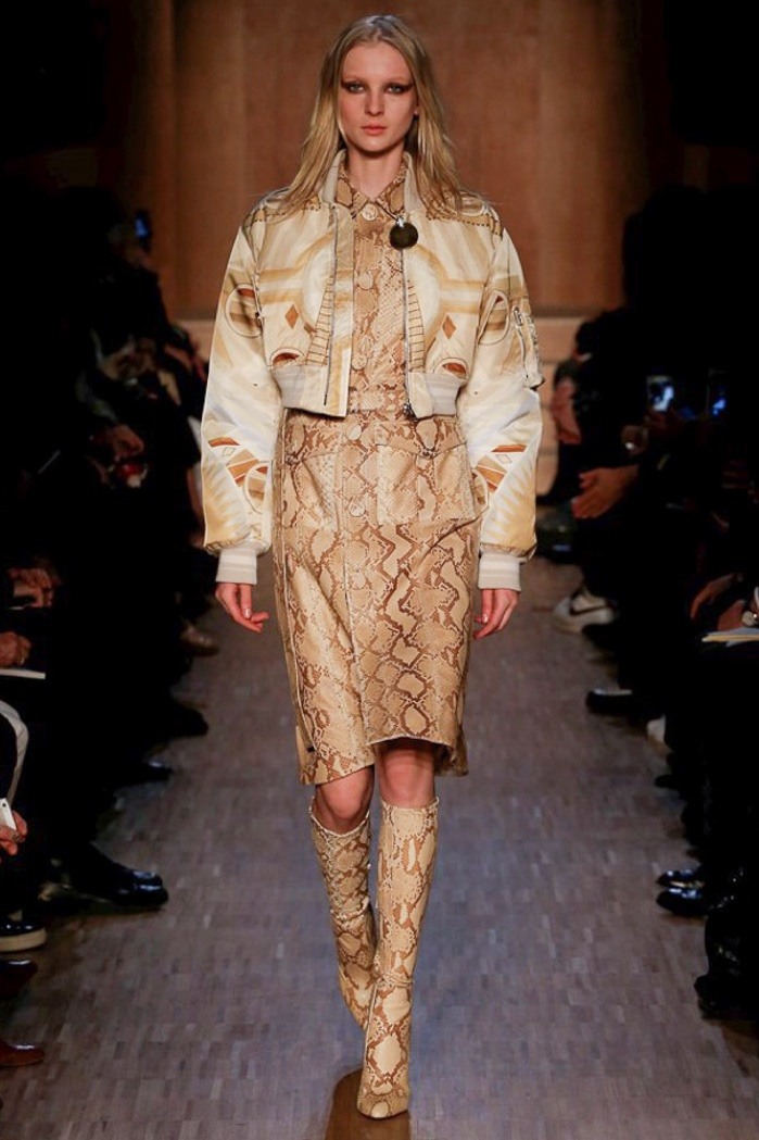A model wears a bomber jacket on Givenchy's fall-winter 2016 runway