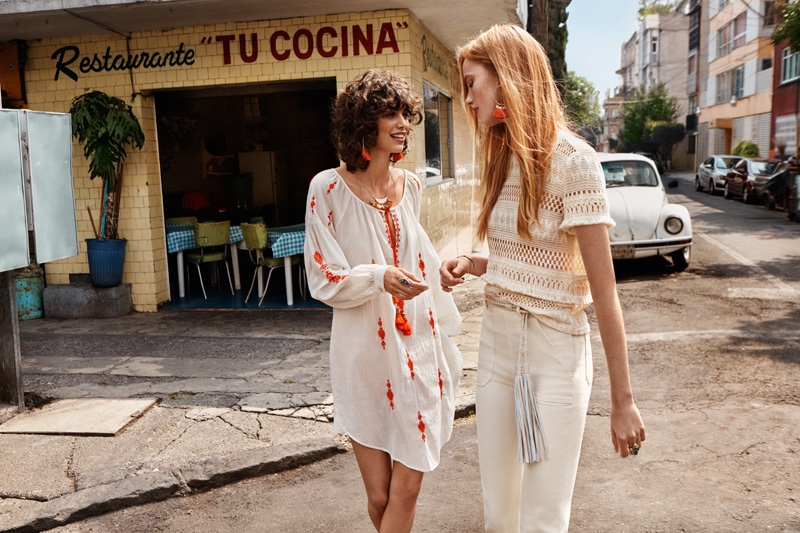 Mica Arganaraz models a long sleeve dress and Rianne models a white t-shirt and jeans from H&M's spring 2016 collection