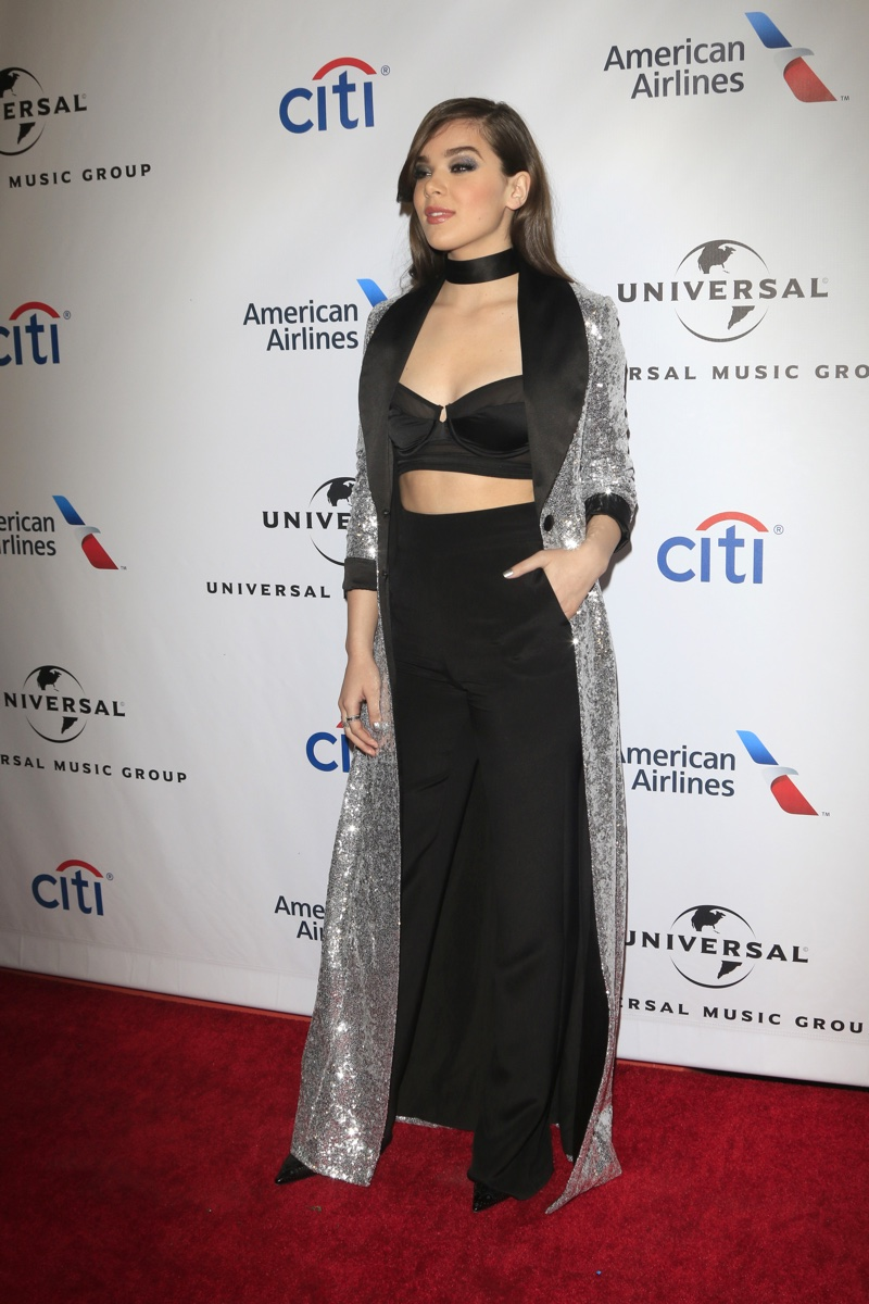FEBRUARY 2016: Hailee Steinfeld attends Universal Music Group's 2016 Grammy After Party wearing a silver coat, black crop top and high-waist trousers. Photo: Helga Esteb / Shutterstock.com
