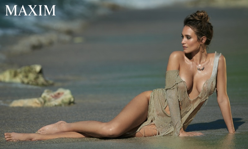 Hannah Davis lounges on the beach in a sexy, barely there coverup