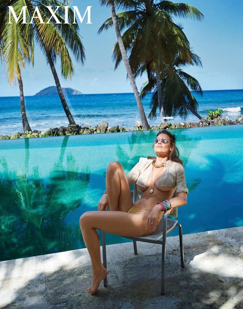 Photographed by Gilles Bensimon, Hannah Davis soaks up the sun in a sexy bikini look