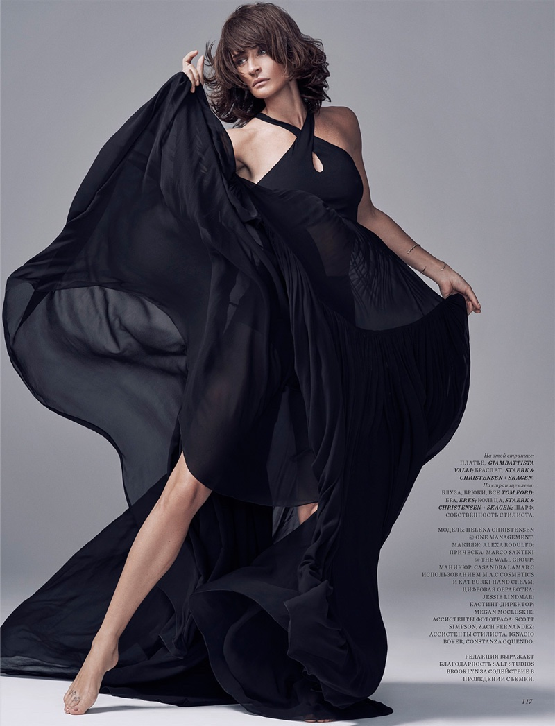 Helena Christensen wears a black gown with a halter neck top