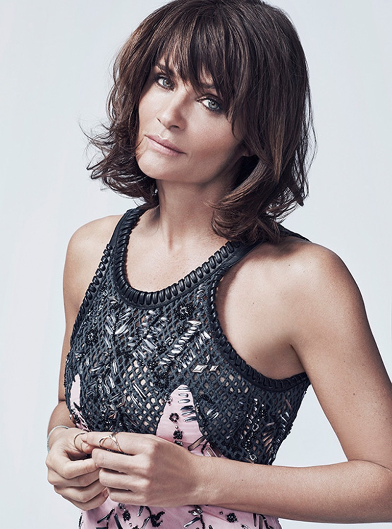 Helena Christensen shows off a medium length hairstyle with bangs parted to the side