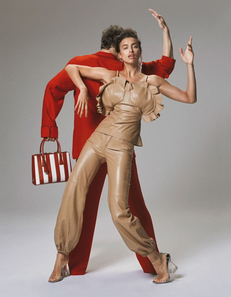 Posing next to a male model, Irina Shayk models a J.W. Anderson top and trousers