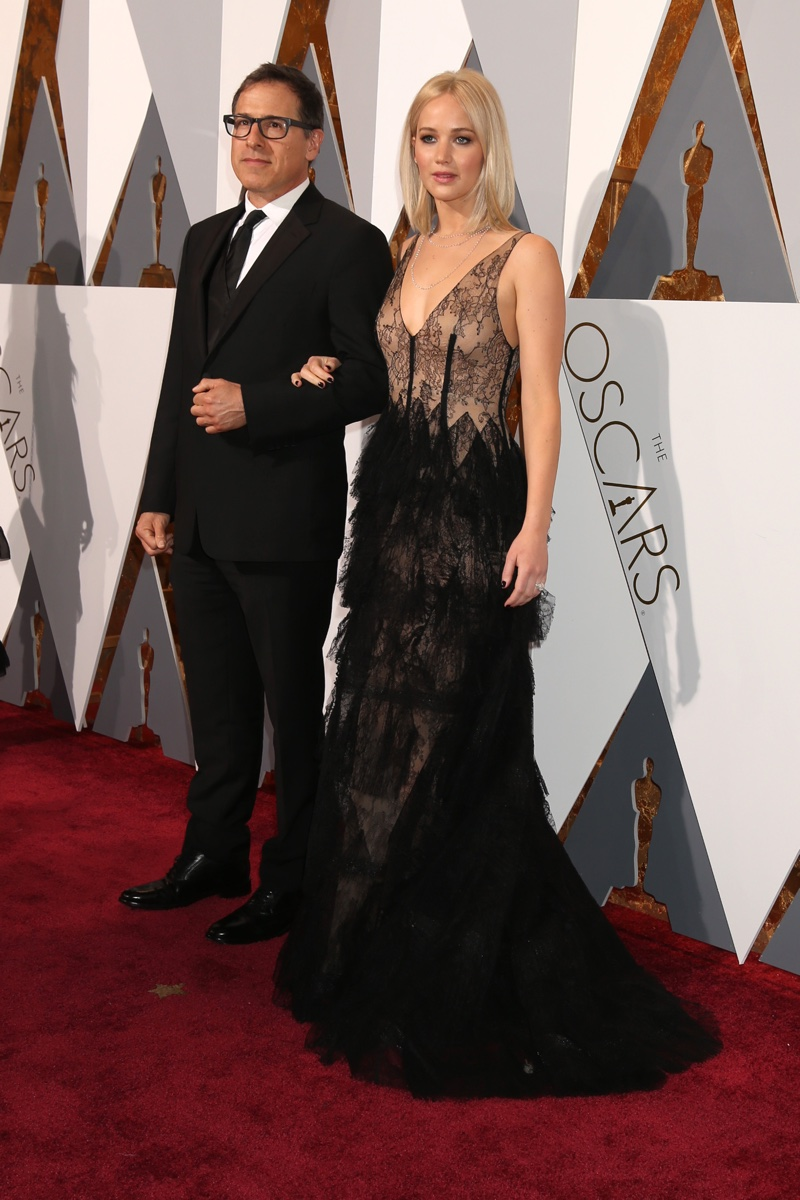 OSCARS 2016 STYLE: Jennifer Lawrence attends the 88th Academy Awards with director David O'Russell wearing a black Dior gown. Photo: Helga Esteb / Shutterstock.com