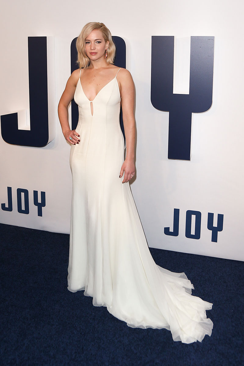 Jennifer Lawrence wears a custom pale yellow Dior slip dress. Photo: Debby Wong / Shutterstock.com