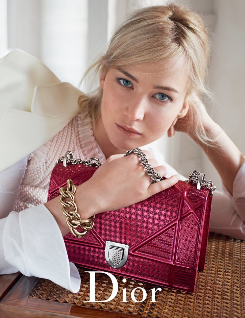 Jennifer Lawrence poses with the label's Diorama handbag in pink
