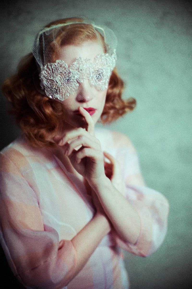 Jessica Chastain poses in white lace mask and Dior silk organza dress