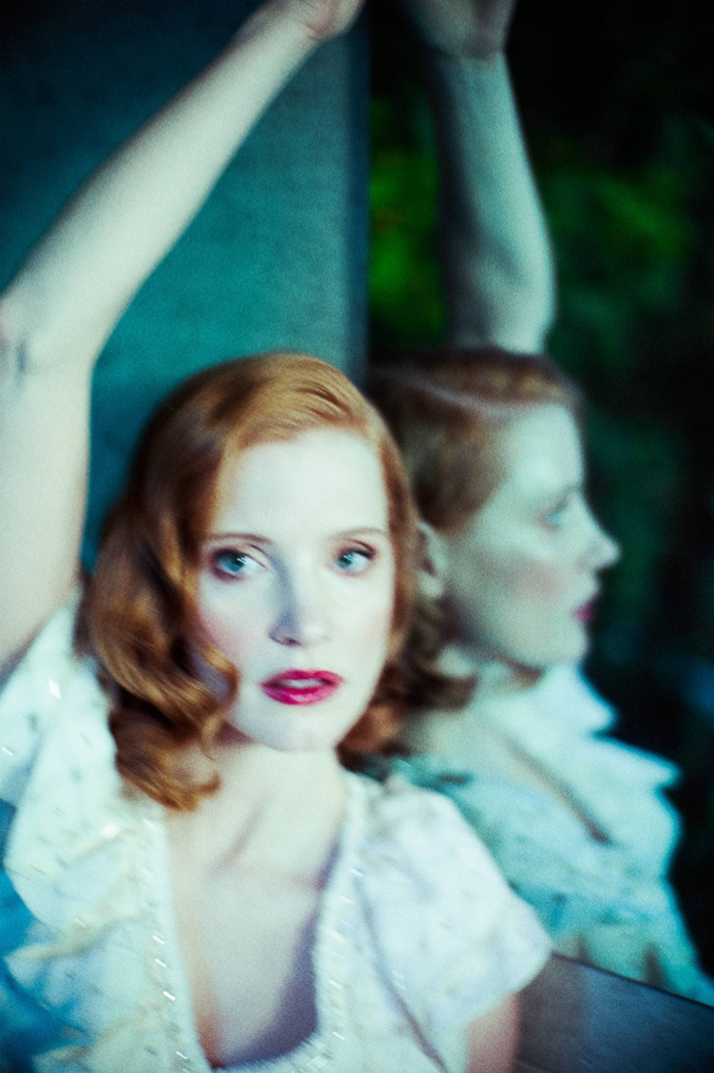 Jessica Chastain shows off a retro inspired beauty look with rouged cheeks and a red lip