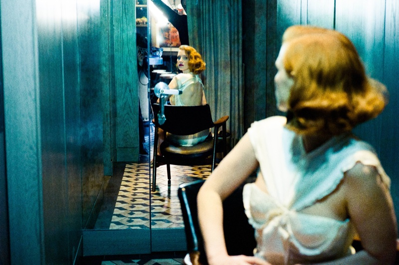 Jessica Chastain looks to the mirror while wearing a Balenciaga playsuit