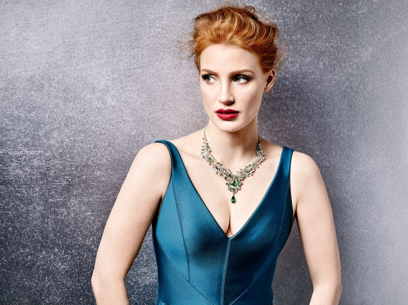 Jessica Chastain poses in emerald necklace from Paiget jewelry
