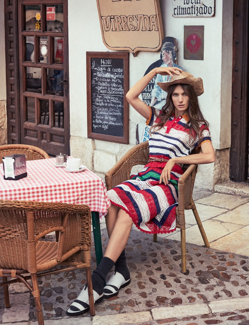 Taking a rest, Jessica Miller poses in a straw hat with a striped print Tommy Hilfiger top and skirt