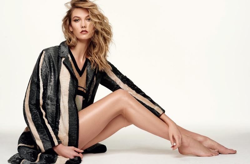 Karlie Kloss flaunts her legs in a striped jacket