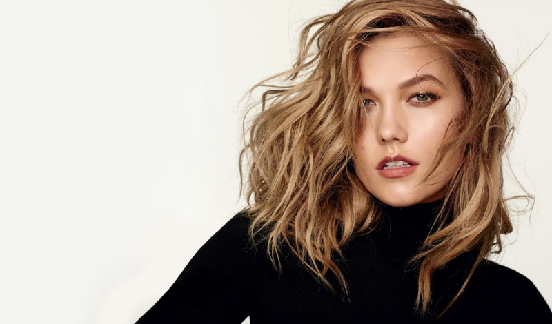 Karlie Kloss poses in a black turtleneck for the fashion editorial