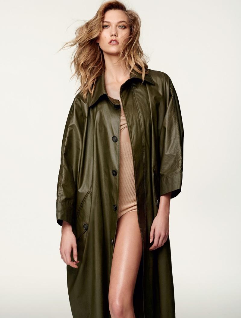 Wearing neutral styles, Karlie Kloss models Adam Lippes coat and Jil Stuart bodysuit