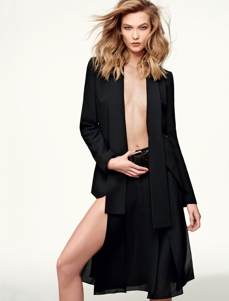 Karlie Kloss shows some skin in a Michael Kors Collection jacket and skirt