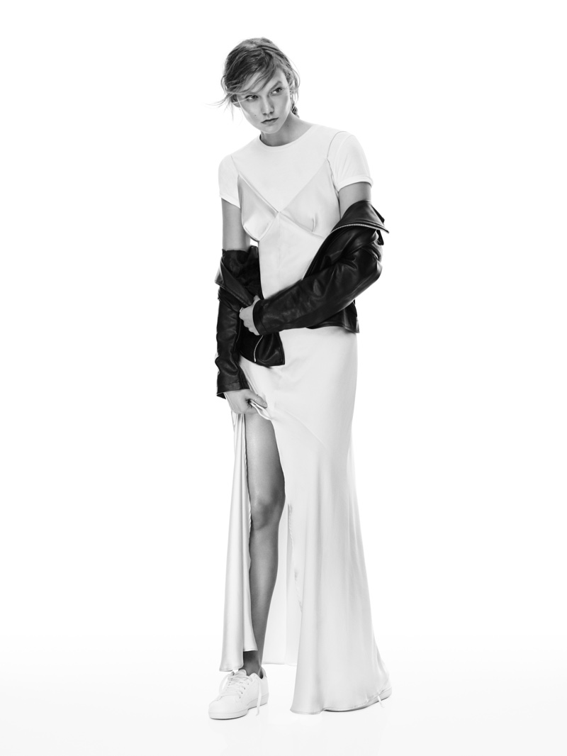 Photographed in black and white, Karlie Kloss wears Mango's long slip dress, white shirt and jacket