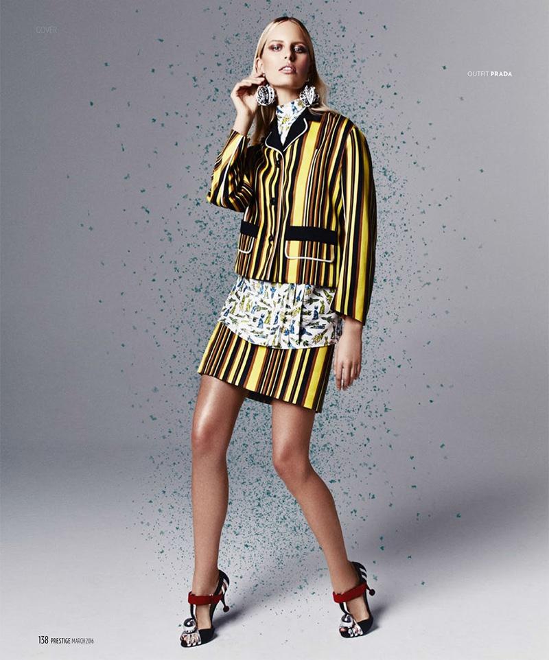 Karolian Kurkova channels 60s mod in a yellow and black striped Prada jacket and mini skirt