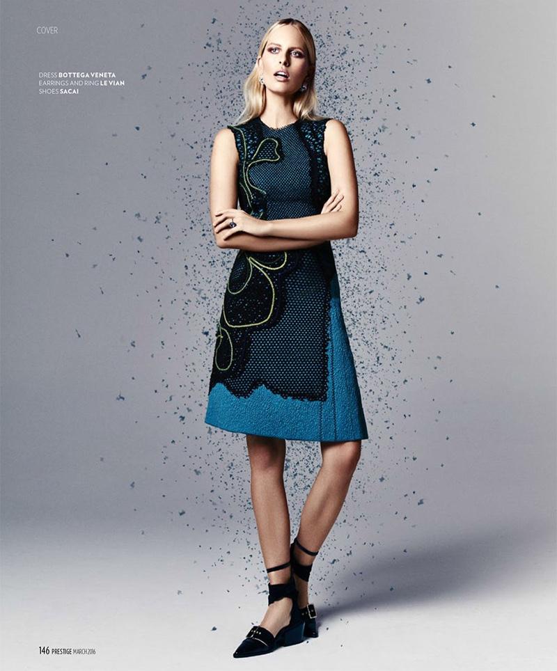 Karolina Kurkova crosses her arms while modeling a blue Bottega Veneta dress