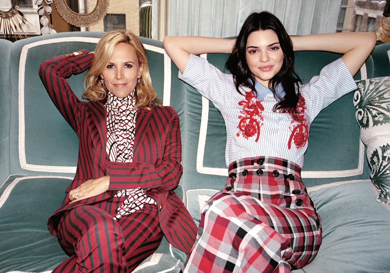 Posing next to Tory Burch, Kendall Jenner looks all smiles in a Tory Burch top and Marc Jacobs skirt