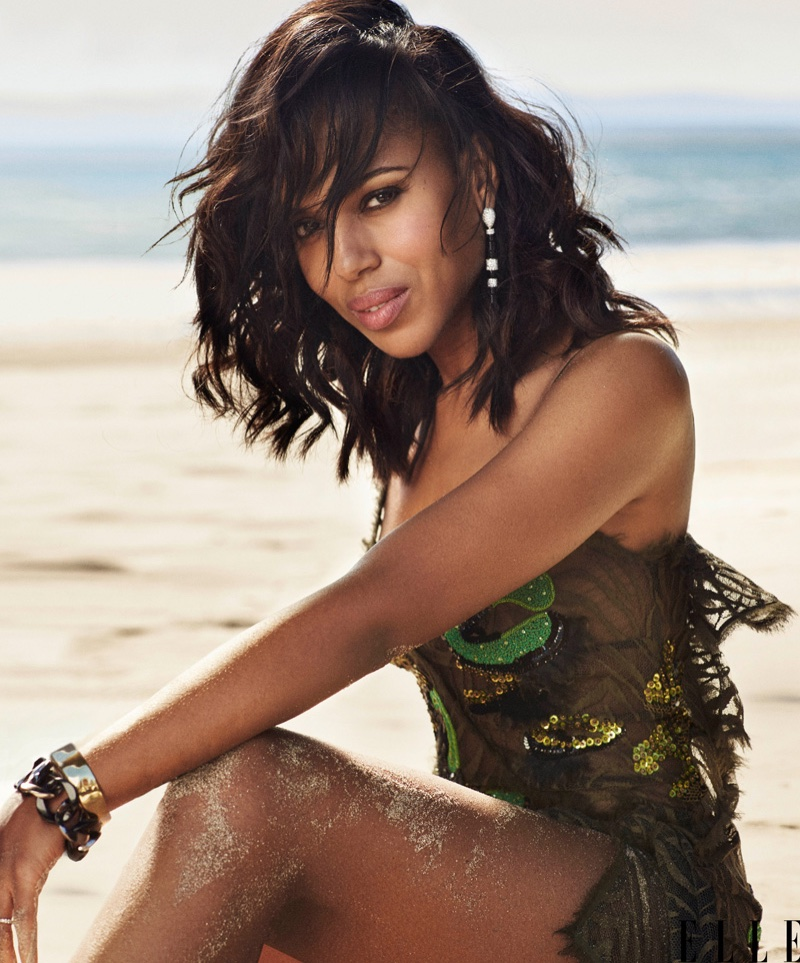 Kerry Washington poses on the beach, wearing a Versace mini dress