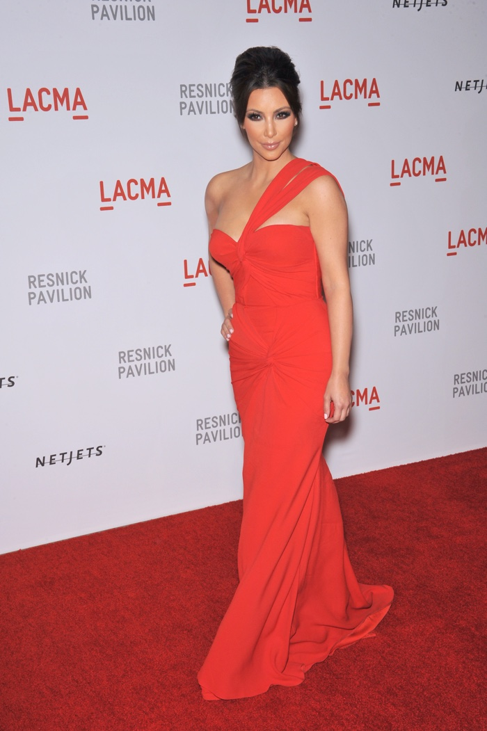 In 2010, Kim Kardashian attended a LACMA event wearing a red gown with one strap. Photo: Jaguar PS / Shutterstock.com