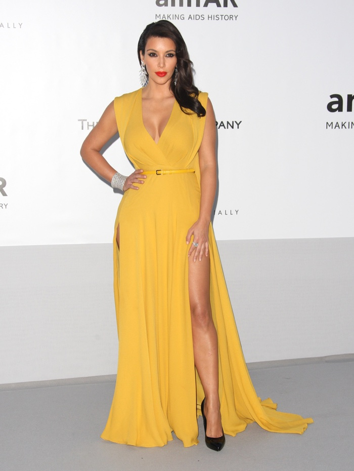 Kim Kardashian turned bombshell at a 2012 amfAR event wearing a yellow gown with a high slit to the side. Photo: Featureflash / shutterstock.com