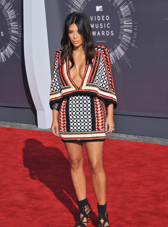 At the 2014 MTV Music Video Awards, Kim Kardashian wore one of her favorite labels Balmain. The star opted for a printed mini dress designed by Olivier Rousteing. Photo: Featureflash / Shutterstock.com
