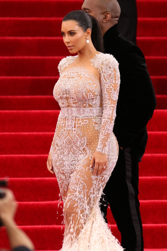 At the 2015 Met Gala, Kim Kardashian went sheer in a crystal embellished Givenchy Haute Couture gown. Photo: JStone / Shutterstock.com