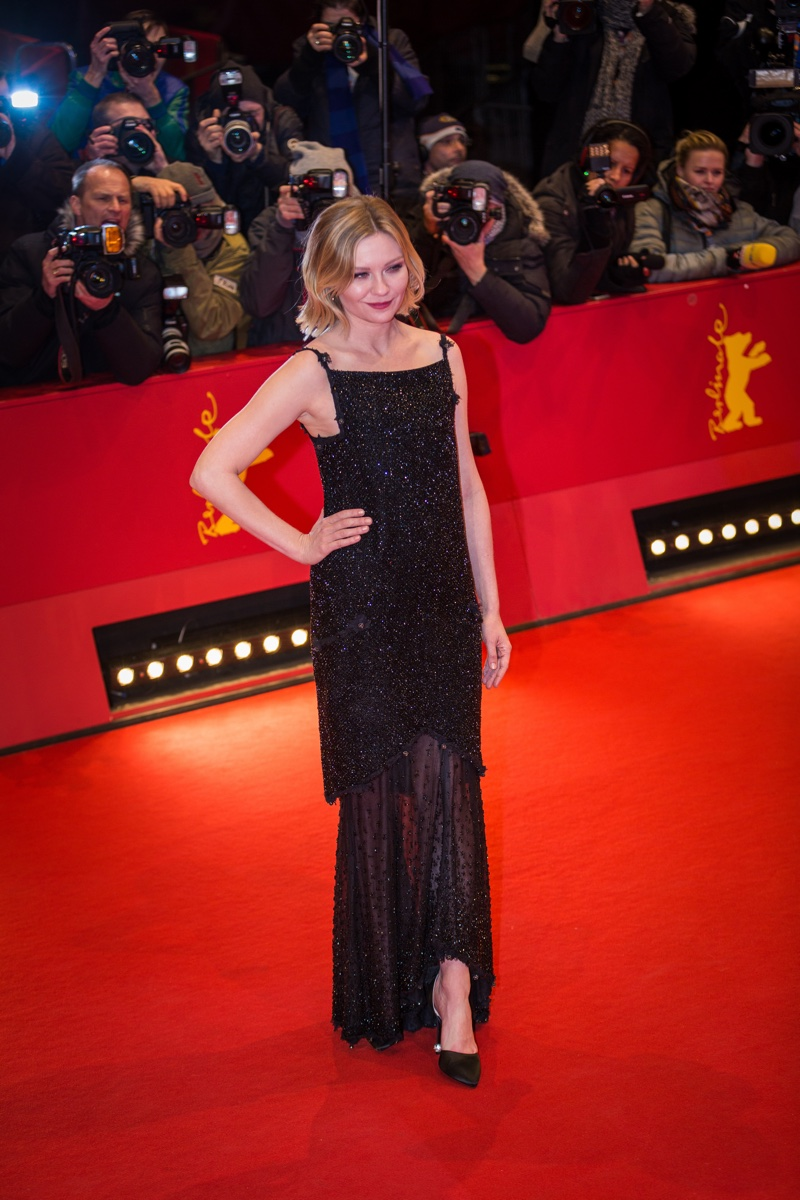 FEBRUARY 2016: Kirsten Dunst attends the Berlin Film Festival premiere of Midnight Special wearing a black beaded dress from Chanel. Photo: taniavolobueva / Shutterstock.com