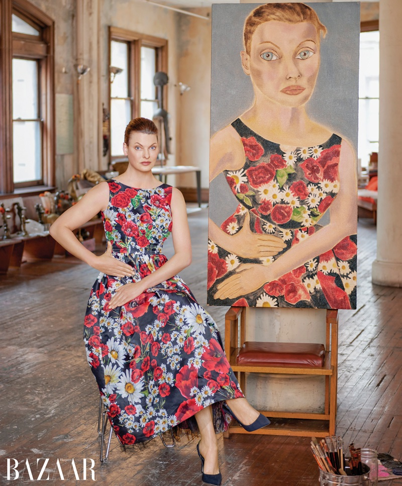 Linda Evangelista poses next to Francesco Clemente portrait. Photo: Harper's Bazaar / Jason Schmidt