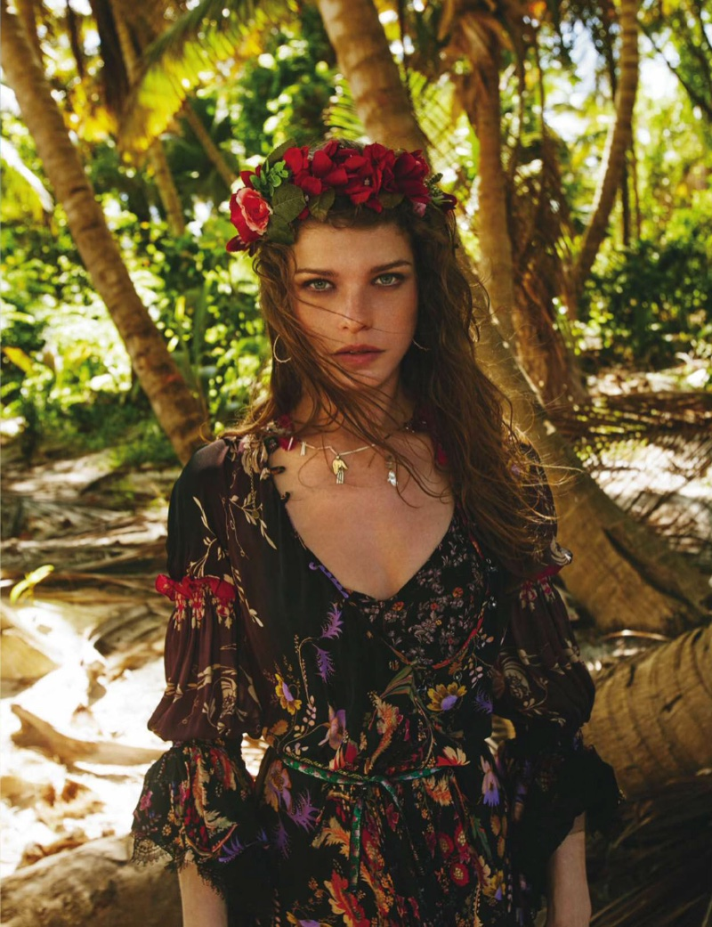 Wearing a flower crown, the model looks boho chic
