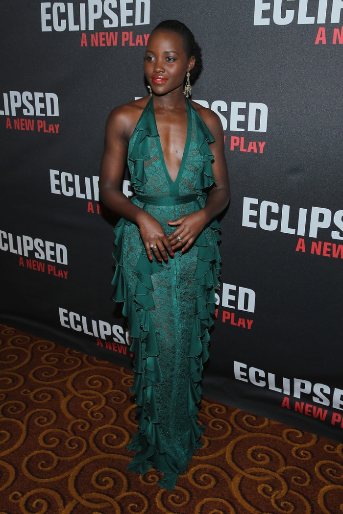 MARCH 2016: Lupita Nyong'o attends the opening night party for Eclipsed wearing a green Balmain dress with ruffles.