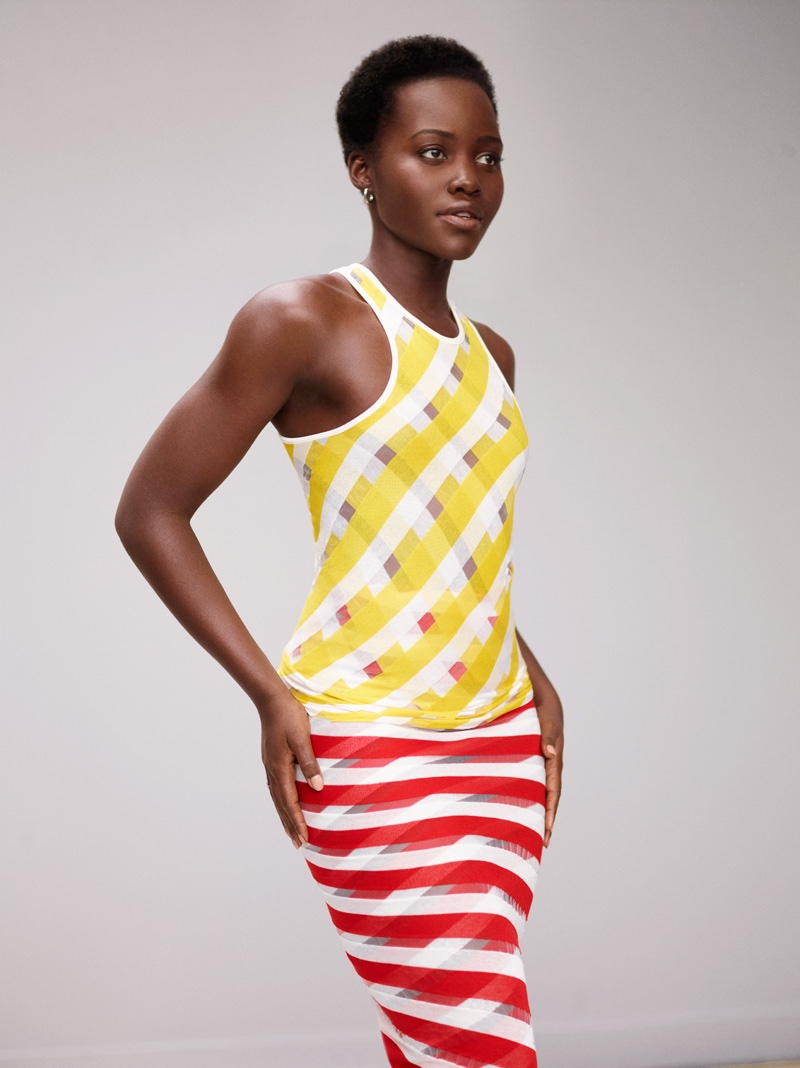 Lupita Nyong'o poses in a Stella McCartney dress in yellow and red