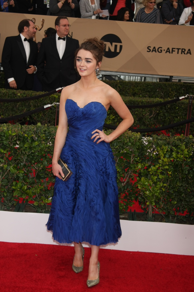 Maisie Williams attends the 2016 SAG Awards wearing a blue Ermanno Scervino dress. Photo: Helga Esteb / Shutterstock.com
