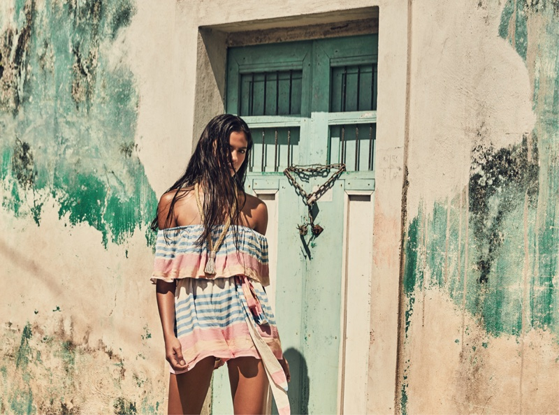 Rania Benchegra models an off the shoulder mini dress from Mara Hoffman