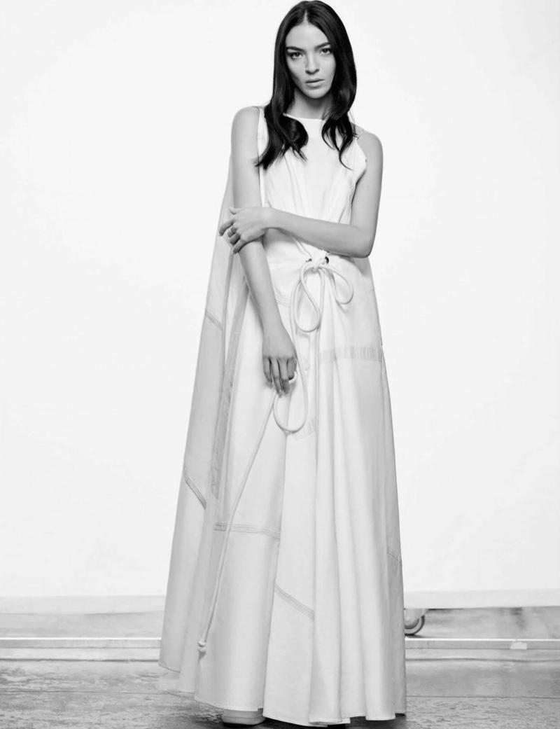 Posing in black and white, Mariacarla Boscono models a maxi dress