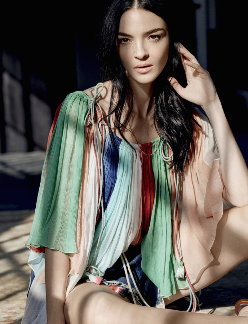 Mariacarla lounges in a multi-colored blouse from Chloe