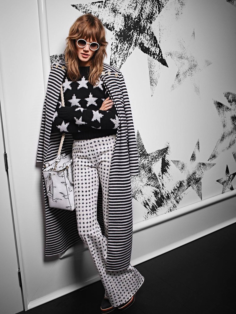 Photographed for Max Mara's spring 2016 campaign, Freja Beha poses in striped coat, star print sweater and high-waisted trousers