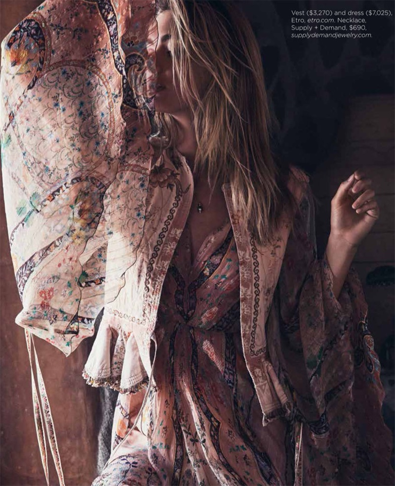 Megan covers up in an Etro jacket with printed maxi dress