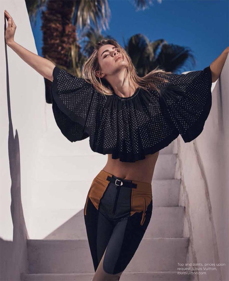 Photographed outdoors, Megan models a Louis Vuitton crop top and high-waist pants