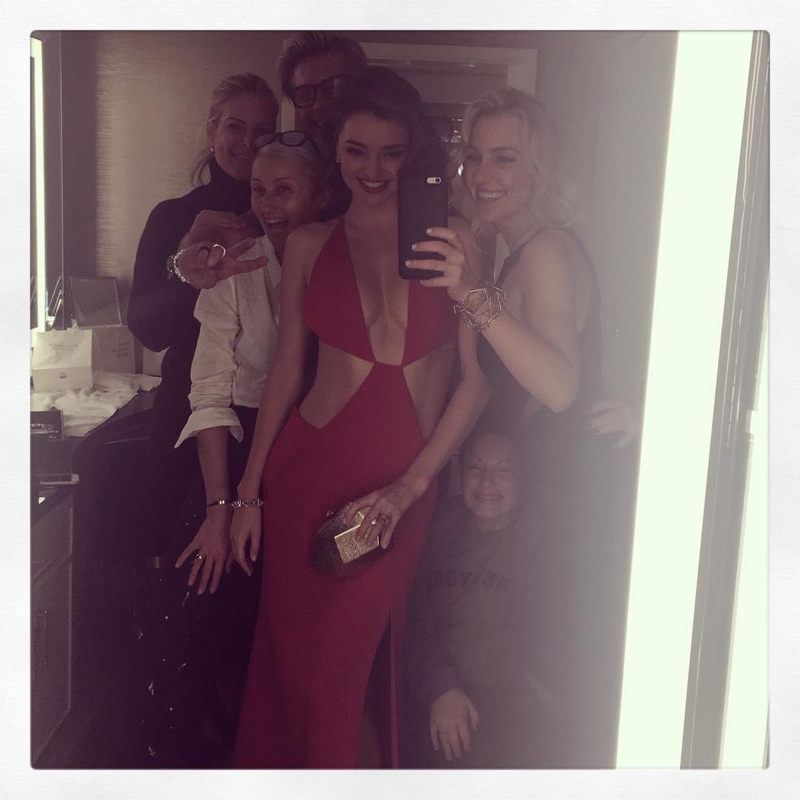 GLAM SQUAD: Miranda Kerr shows off her red Kaufman Franco dress while surrounded by her glam squad. Photo: Instagram/mirandakerr