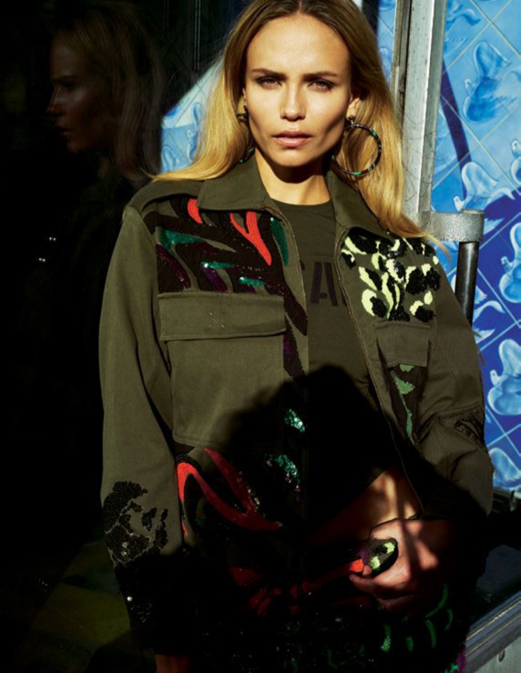 Natasha Poly models a military inspired jacket from Versace