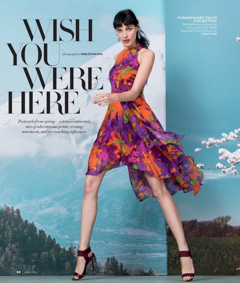Photographed for Neiman Marcus, Kati Nescher models a multicolor print dress designed by Carmen Marc Valvo Collection
