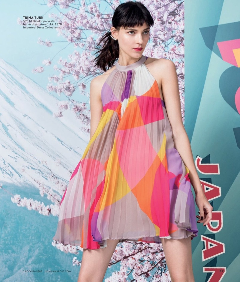 The model serves mod vibes in a multicolor Trina Turk dress with a halter neckline