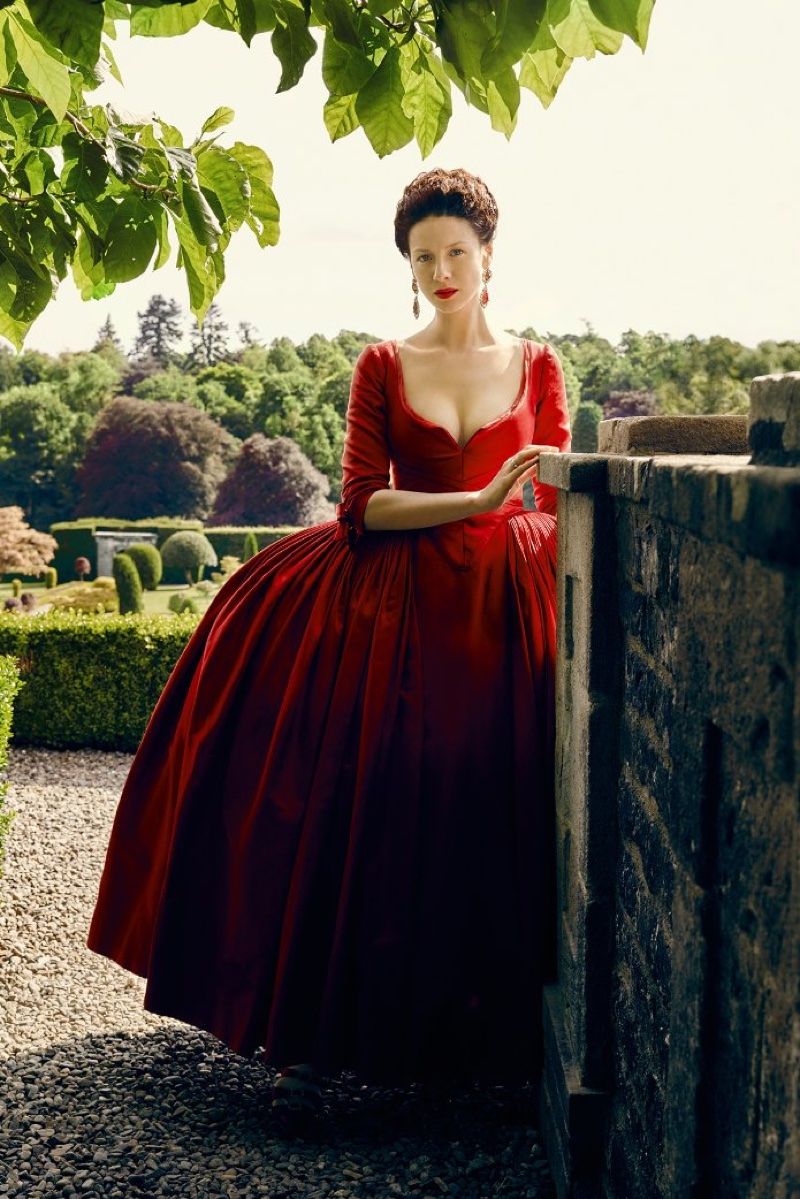 Caitriona Balfe as Claire Randall in Outlander season 2 promotional image wearing a red dress. Photo: Starz